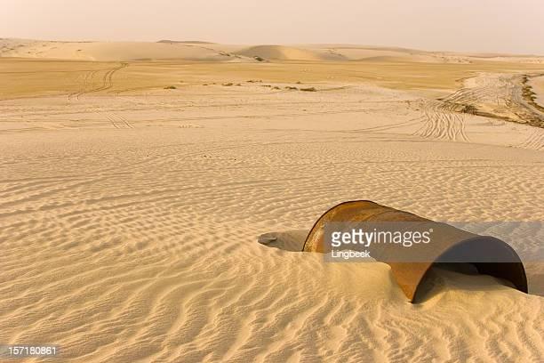 Rusty barrel in the desert