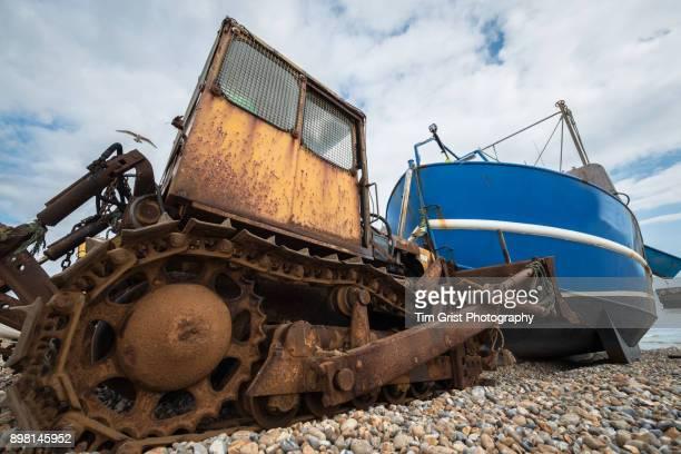 Rusty Bulldozer and Boat