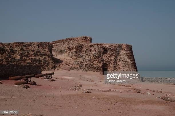 Rusty canons are seen in the ruins of the Portuguese Castle on May 2 2017 in Hormuz Island Iran The Fort of Our Lady of the Conception also known as...