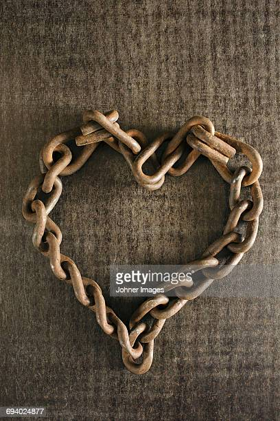 Rusty chain in heart shape