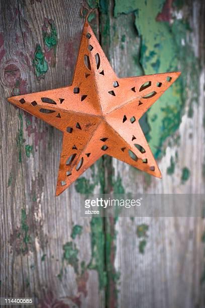 Rusty christmas star on rustic old door shallow dof