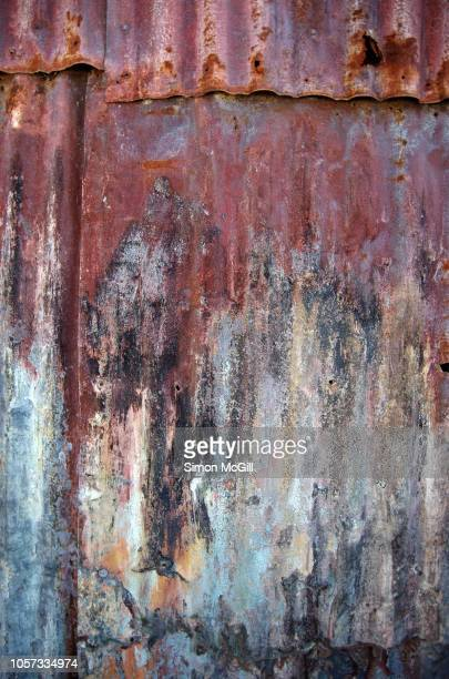 rusty corrugated iron on the side of a shed - ugly wallpaper stock photos and pictures