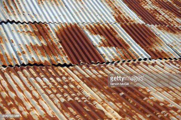rusty corrugated iron roof on an agricultural shed - rust colored stock photos and pictures