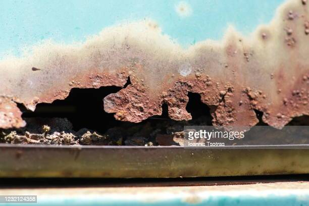 rusty damaged surface - close up - rust colored stock pictures, royalty-free photos & images