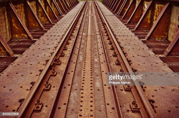 Rusty disused railway bridge over Don River, Toronto