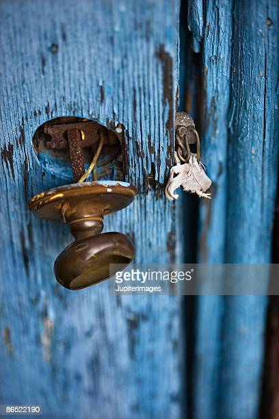 Rusty doorknob on weathered door