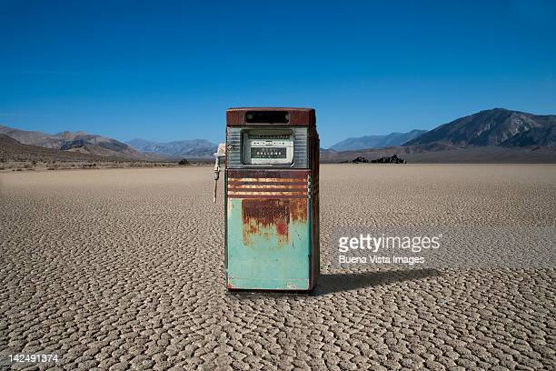 rusty gas pump in a desert