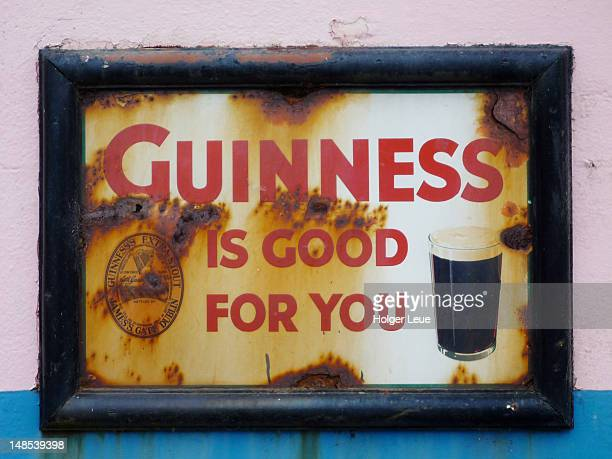 rusty guinness sign outside dan foley's pub. - guinness stock pictures, royalty-free photos & images