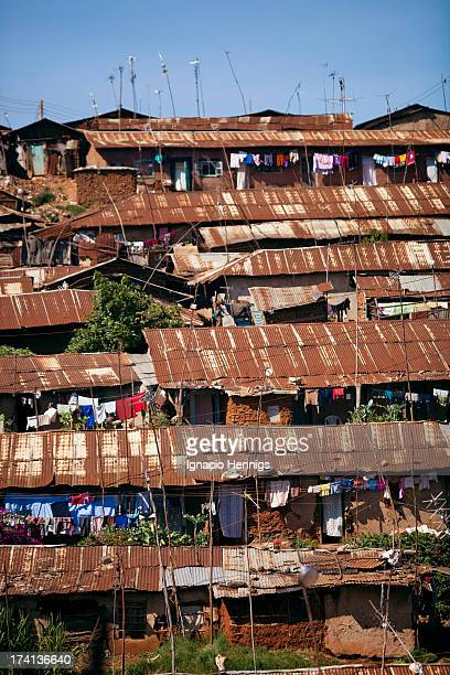 """Rusty iron sheets in Kibera, a informal settlement located in the outskirts of Nairobi. It is known also by its settlers as """"the chocolate city""""..."""