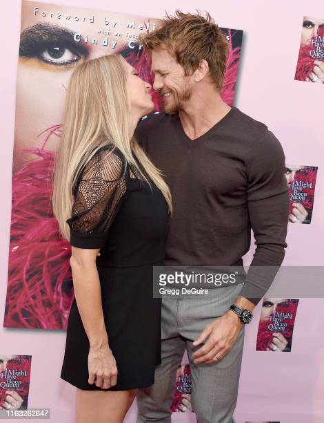 Rusty Joiner and Charity Walden attend the Brian Edwards Book Release Event at The Malibu Lumber Yard on August 22 2019 in Malibu California