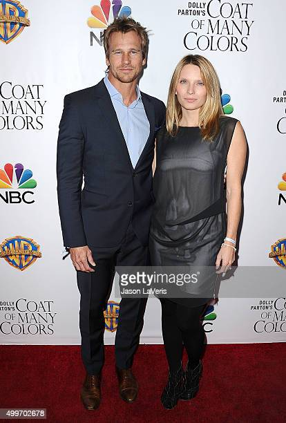 Rusty Joiner and Charity Walden attend the premiere of Dolly Parton's Coat Of Many Colors at the Egyptian Theatre on December 2 2015 in Hollywood...