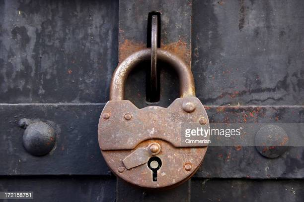 A rusty lock on a metal medieval door
