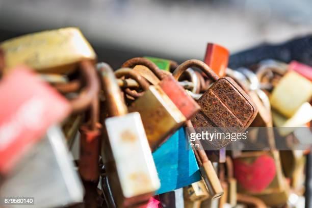 Rusty love lock between many other love locks