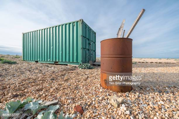 rusty oil drum and shipping container, dungeness - drum container stock photos and pictures