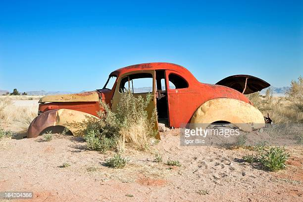 Rusty old abandoned car in the namib desert in Namibia.