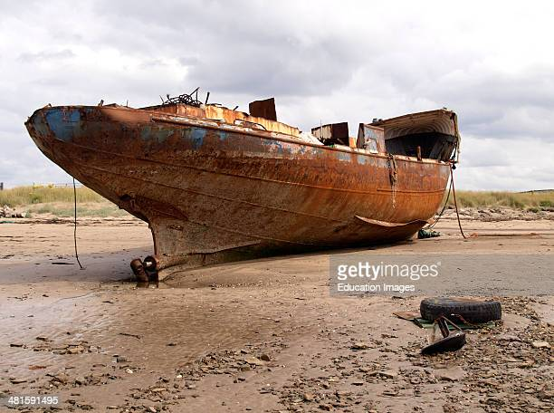 Rusty old ship beached on the River Taw estuary at Yelland Instow Devon UK