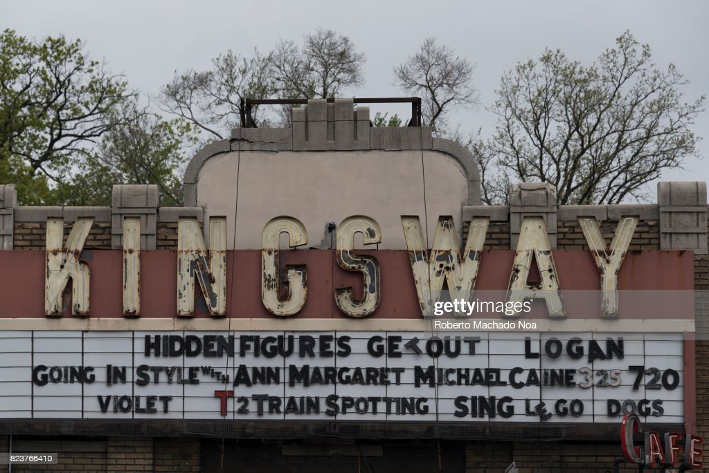 Rusty Old Signage Of Kingsway Cinema In Front Of Trees And A