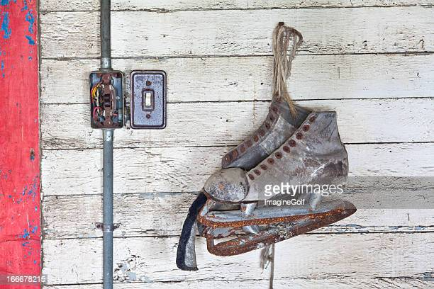Rusty Old Skates on a Wall