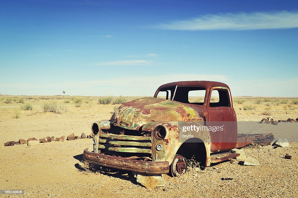 Rusty old wreck abandoned in the Namibia Desert : Stock Photo
