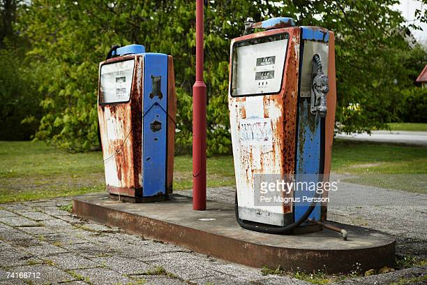 rusty petrol pumps on a gas station. - distributore di benzina foto e immagini stock