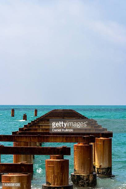 rusty pier - belek stock pictures, royalty-free photos & images