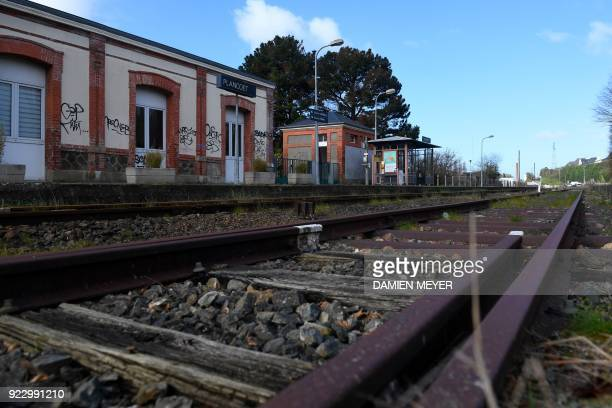Rusty rails are pictured at a rail station in Plancoët western France on February 20 2018 A report by former Air France Chief Executive JeanCyril...