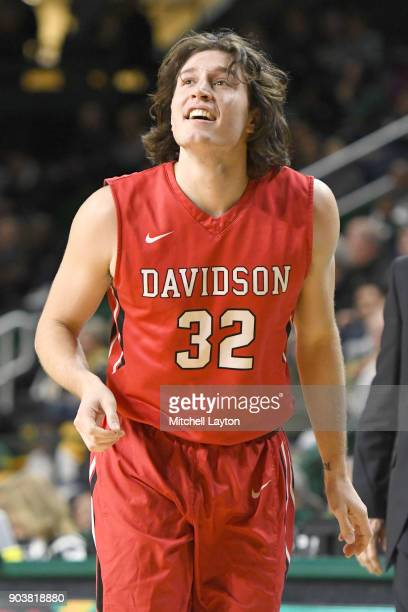 Rusty Reigel of the Davidson Wildcats looks on during a college basketball game against the George Mason Patriots at the Eagle Bank Arena on January...