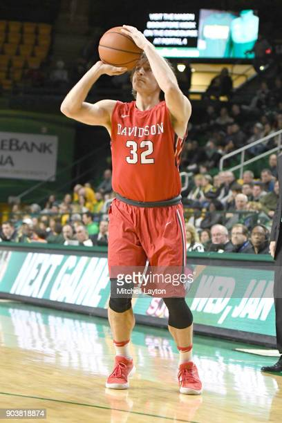 Rusty Reigel of the Davidson Wildcats takes a jump shot during a college basketball game against the George Mason Patriots at the Eagle Bank Arena on...