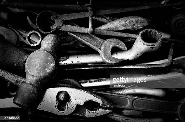 rusty set of tools in black and white