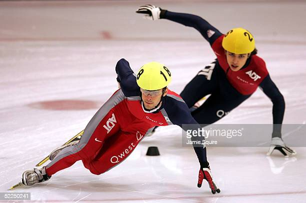 Rusty Smith competes against Kyle Carr in the Men's 1000 Meter Semifinals during the U.S. Nationals Short Track Speed Skating Championships on...