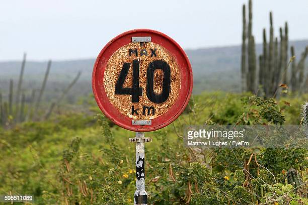 rusty speed limit sign on field - number 40 stock photos and pictures