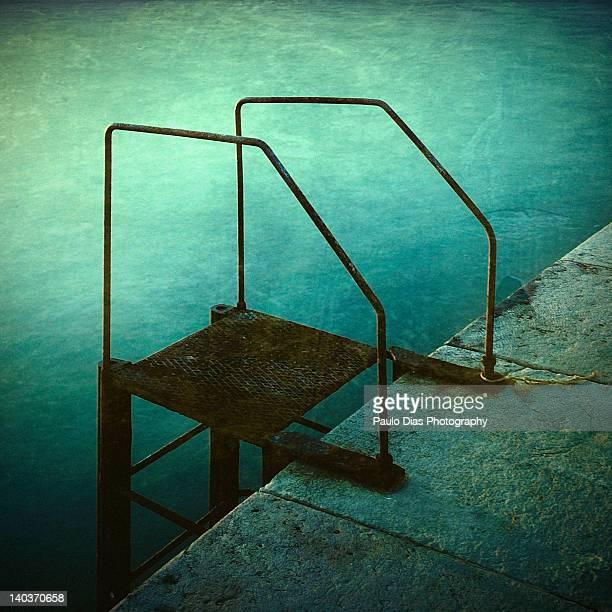 Rusty swimming pool ladder