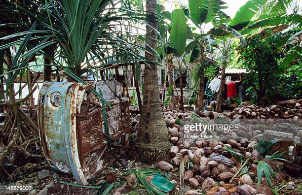 Rusty vehicle and coconut shells.