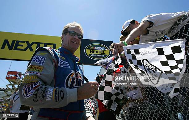 Rusty Wallace, driver of the Miller Lite Dodge, signs autographs during the NASCAR Nextel Cup Pennsylvania 500 qualifying on July 23, 2005 at Pocono...