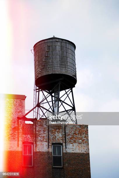 Rusty water tower on a rooftop in Manhattan, New York City, USA