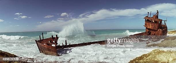 rusty wreck on bimini beach - bimini stock photos and pictures