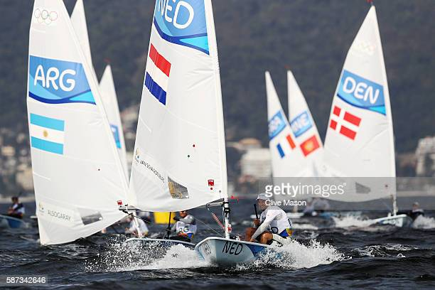 Rutger van Schaardenburg of the Netherlands competes during the Men's Laser Race 1 on Day 3 of the Rio 2016 Olympic Games at Marina da Gloria on...