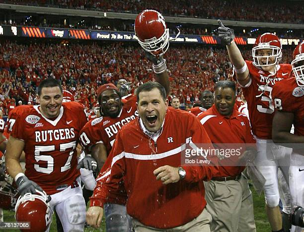 Rutgers head coach Greg Schiano reacts to getting dumped with water after their victory. The Scarlet Knights beat the Panthers 37-10 in the inaugural...