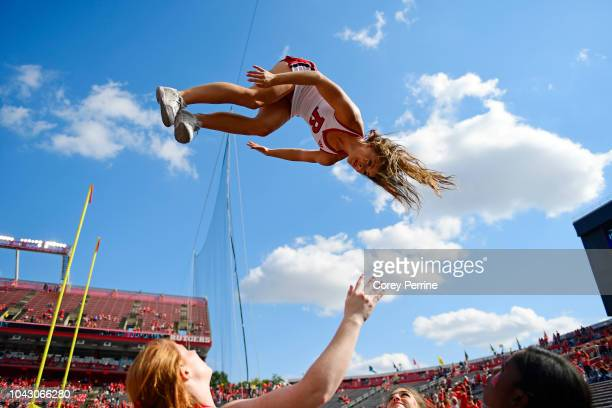 Rutgers Scarlet Knights cheerleader performs a stunt during the fourth quarter between the Rutgers Scarlet Knights and the Indiana Hoosiers at...