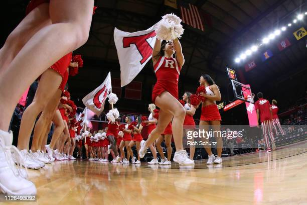 Rutgers Scarlet Knights cheerleaders lead the team out before a game against the Indiana Hoosiers at Rutgers Athletic Center on January 30 2019 in...