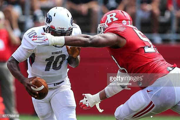 Rutgers Scarlet Knights defensive lineman Julian PinnixOdrick chases Howard Bison quarterback Jason Collins during the game between the Rutgers...