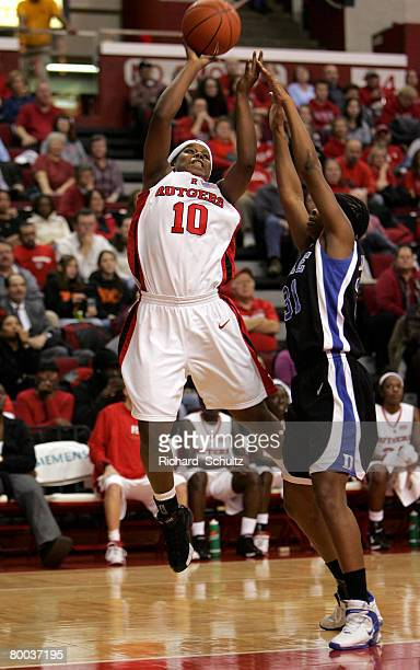 Rutgers Scarlet Knights' Epiphanny Prince takes a shot as Duke Blue Devils' Keturah Jackson defends during the second half of NCAA women's basketball...