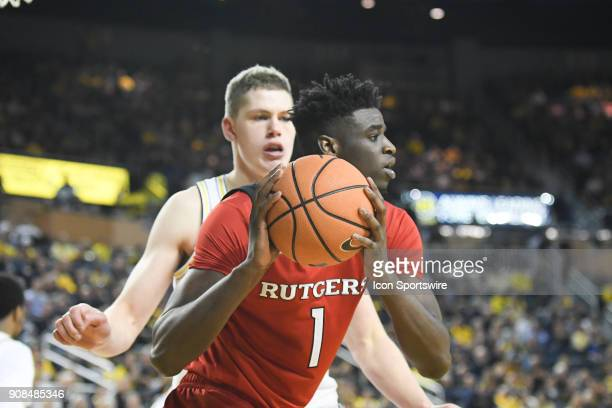 Rutgers Scarlet Knights forward Candido Sa looks to pass the ball with Michigan Wolverines forward Moritz Wagner defending him during the Michigan...