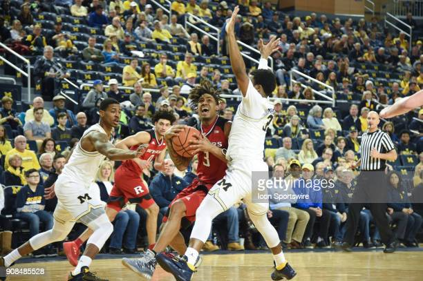 Rutgers Scarlet Knights guard Corey Sanders drives the lane on Michigan Wolverines guard Zavier Simpson during the Michigan Wolverines game versus...