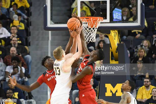 Rutgers Scarlet Knights guard Mike Williams blocks this shot attempt by Michigan Wolverines forward Moritz Wagner during the Michigan Wolverines game...