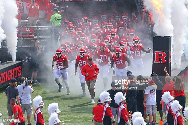 Rutgers Scarlet Knights head coach Chris Ash leads his team onto the field prior to the game between the Rutgers Scarlet Knights and the Howard Bison...