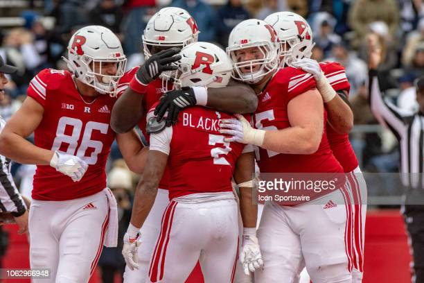 Rutgers Scarlet Knights players mob running back Raheem Blackshear after his touchdown run during the fourth quarter of the college football game...