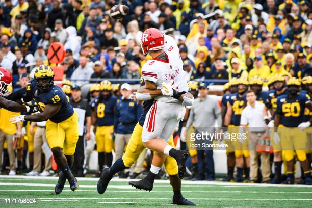Rutgers Scarlet Knights quarterback Artur Sitkowski just gets a pass away while being hit by Michigan Wolverines linebacker Josh Uche during the...