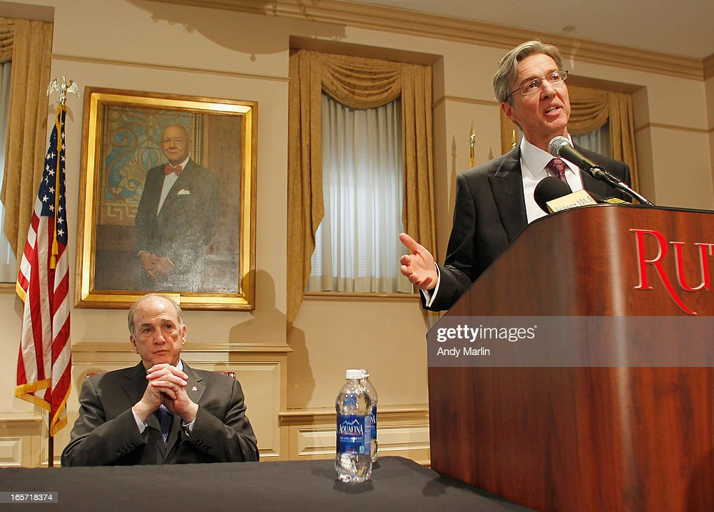 Rutgers University Board of Governors Chair Ralph Izzo (R) addresses the media as Rutgers University President Robert L. Barchi looks on during a press conference at Rutgers University announcing the resignation of Athletic Director Tim Pernetti on April 5, 2013 in New Brunswick, New Jersey. Pernetti resigned after the firing of the basketball coach Mike Rice for abusive conduct toward players.