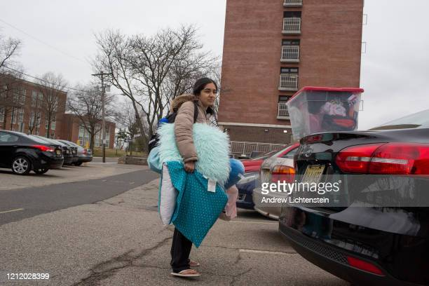 Rutgers University students move out of their dorms after being given two days to vacate campus which is shutting down due to concerns over the...